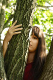 Girl looking out of tree Stock Photo