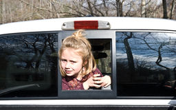 Girl Looking Out of Truck Stock Photography