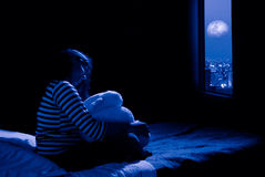 Girl looking out at window royalty free stock photos