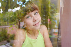 Girl looking out window Stock Photo