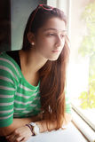 Girl looking out window Stock Photography