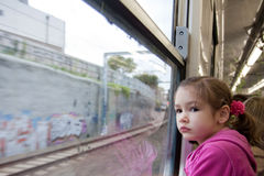 Girl looking out window of train Royalty Free Stock Images