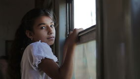 Girl looking out window on train