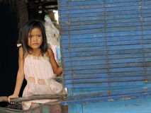 Girl looking out from wooden house Tonle Sap Lake Cambodia Royalty Free Stock Photos
