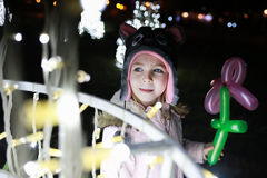 Girl looking Outdoor Christmas decorations Royalty Free Stock Image