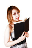 Girl looking over book. Royalty Free Stock Image
