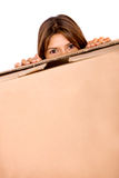 Girl looking over a box Royalty Free Stock Photos