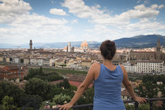 Girl looking over Florence in Italy Royalty Free Stock Image