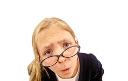 Girl Looking Over Glasses. Cute Young Girl Looking Over Glasses at Camera Stock Images