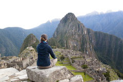Girl looking over Machu Picchu Royalty Free Stock Photography