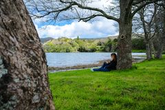 Girl looking over Sete Cidades lake into the mountains, Azores, Portugal stock images
