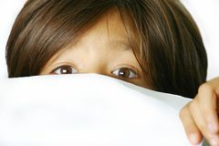Girl looking over white paper royalty free stock images