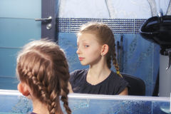 Girl looking at own reflection Stock Photo