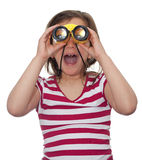 Girl looking through a pair of binoculars Stock Photos