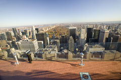 Girl looking at panoramic view of New York City and Central Park from �Top of the Rock� viewing area at Rockefeller Center, Ne Stock Photos