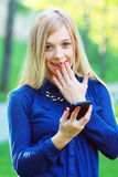 Girl looking at phone Stock Photography