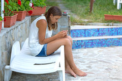 Girl looking at phone Royalty Free Stock Image