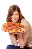 Girl looking at a pizza. Girl smiling and looking at a pizza royalty free stock photo