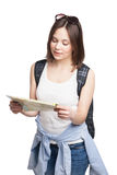 Girl looking for place on  map with rucksack Stock Image