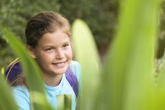 Girl Looking At Plants Royalty Free Stock Photo