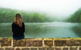 girl looking at the lake stock images