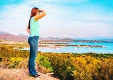 Girl looking at Porto Rotondo Golfo Aranci Mediterranean Sea in Costa Smeralda in Sardinia in Italy. Girl looking at Porto Rotondo on Golfo Aranci the royalty free stock photography