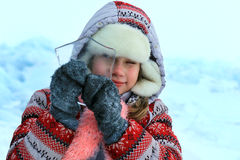 Girl looking through a pure ice. focus on face Royalty Free Stock Image