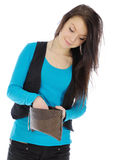 Girl looking into purse Royalty Free Stock Photos