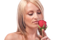 Girl looking at red rose Royalty Free Stock Images