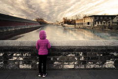 Girl looking at river in Forbidden City Royalty Free Stock Photos