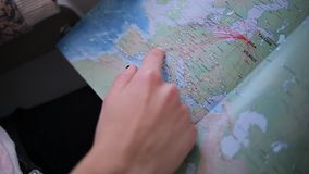 Girl looking routes on the map stock video