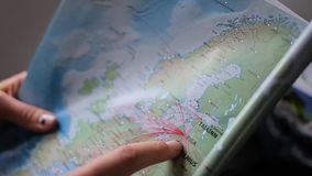 Girl looking routes on the map stock footage