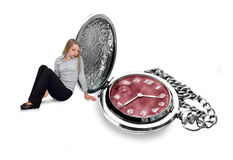 Girl looking sad at silver pocket watch Royalty Free Stock Photo