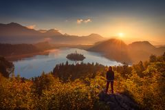 Girl looking scenery of Bled lake in Slovenia royalty free stock photo