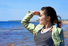Girl looking at the sea Royalty Free Stock Image
