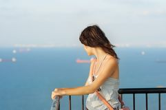 Girl looking on sea. Portrait of young woman looking on sea Royalty Free Stock Photography