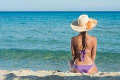 Girl Looking At Sea. Young Woman Sitting And Looking At Sea Stock Image