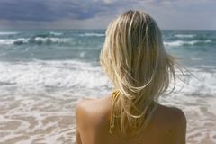 Girl looking into sea Royalty Free Stock Images