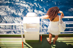Girl looking the sea. MESSINA, ITALY - AUGUST, 26: Girl looking the sea from ferry-boat on August 26, 2015 Stock Images
