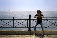 Girl looking at the sea Stock Images