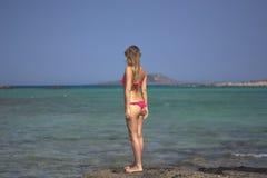 Girl looking at the sea Royalty Free Stock Photo