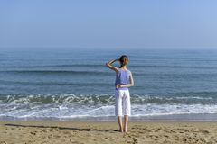 Girl looking at the sea royalty free stock photo