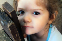 Girl looking seriously. Little child girl looking seriously Royalty Free Stock Photo