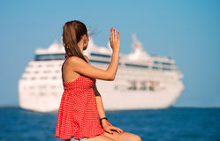 Girl looking at the ship Stock Photography
