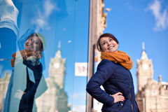 Girl is looking at shop window Royalty Free Stock Image