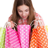 Girl looking into shopping bags Stock Photo