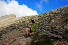 Girl looking at the Skala peak in the distance Royalty Free Stock Photography