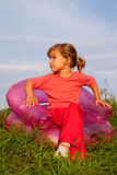 Girl looking at the sky in inflatable armchair Royalty Free Stock Photo