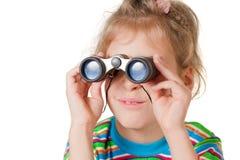 A girl looking through a small binocular Royalty Free Stock Photos