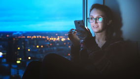 Girl Looking at Smartphone on City Background stock footage